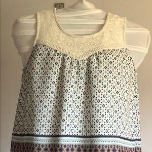 Couture sleeveless soft geometric blouse